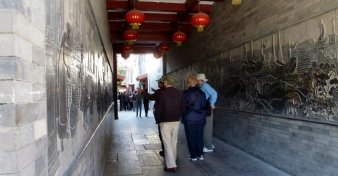 In Tianjin, China. Ancient Culture Street wall panels in a passageway tell of Tianjin's history. 2014