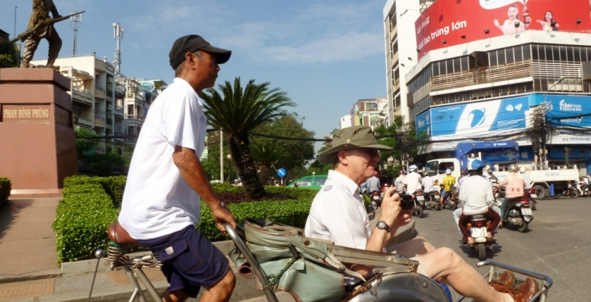 Rog having fun, Cyclo riding in Saigon, Vietnam.