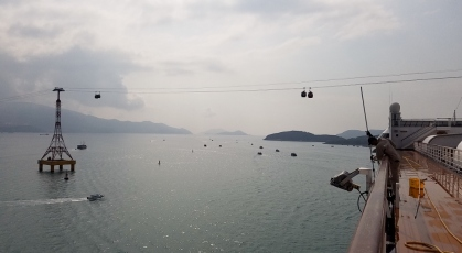 On the dock in Nha Trang, Vietnam with the cable cars running overhead. And lots of smog!