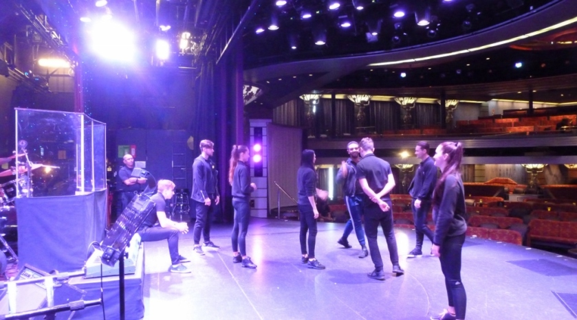 Milling about the stage with the cast and crew during a backstage tour.