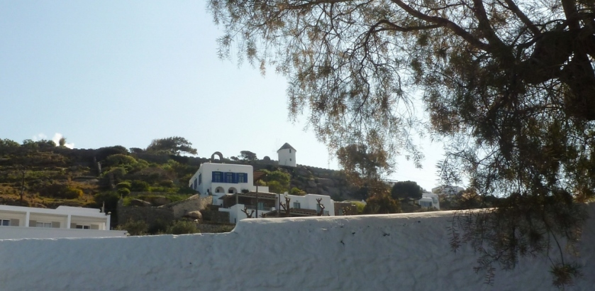 On the hill above the old port , one of the famous windmills of Mykonos