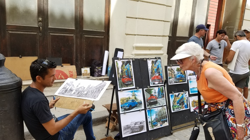 A local artist works and sells his lovely images.