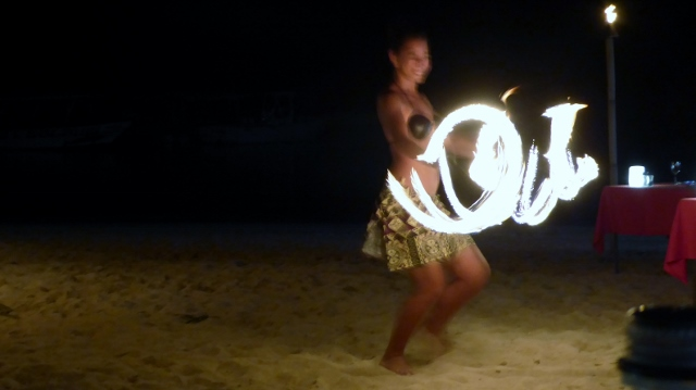 The lovely young ladies are much more graceful--even while playing with fire!!