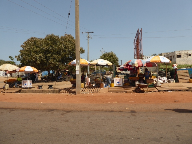 Markets set up along the road to Kotu Beach