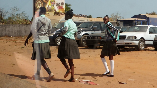 School girls carrying no books.