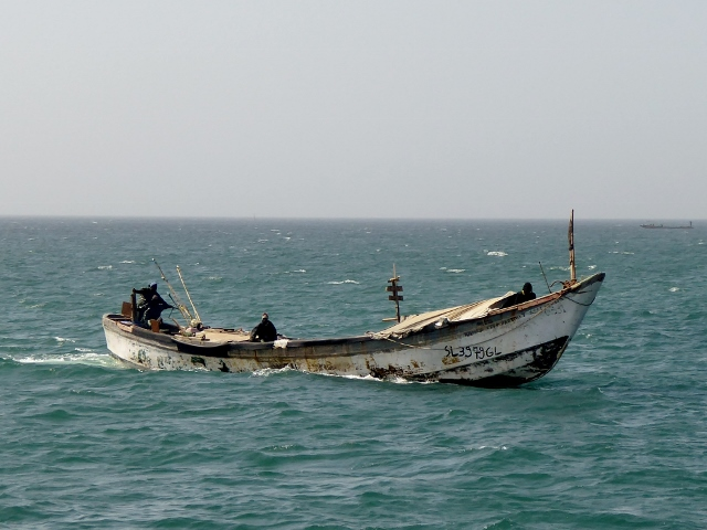 Passing a fishing boat as we return to Dakar on the mainland.