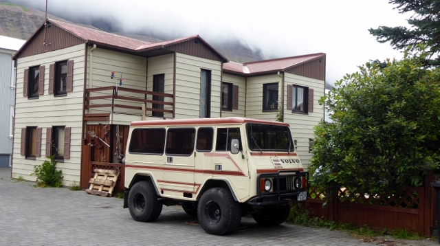 Like the vehicle!  What is it?  A Volvo van?  It matches the house!!!!!
