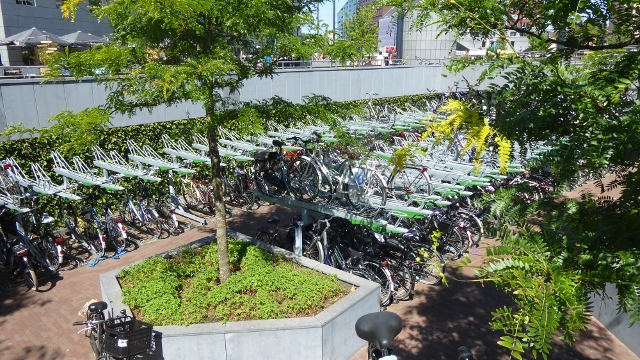 A multi-tiered parking garage for bicycles.