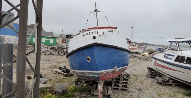 As we strolled back to the tender dock, we spotted this quaint little old boat.