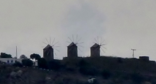 Windmills on a hillside above the town.