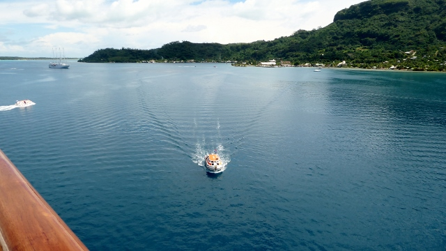 We are anchored in the Bora Bora Lagoon and tender to the dock.