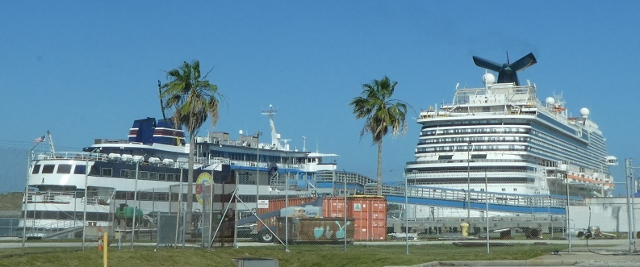 The victory Casino Ship and the Carnival Breeze.