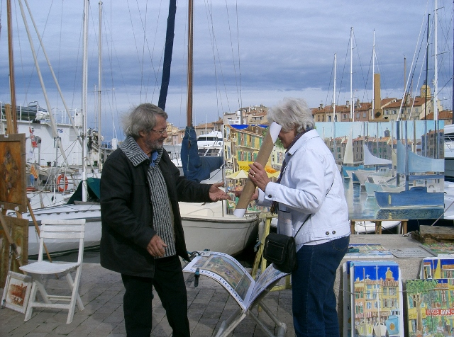 Buying artwork from local artist, Michel Guy-Nochet, in St Tropez.