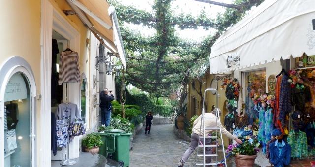 Positano merchants with their inviting shoppes beckon along the way.